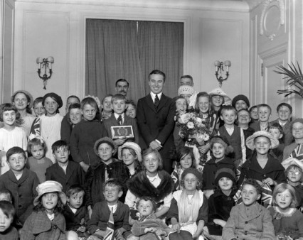 Charlie Chaplin at the Ritz with 50 children from Hoxton in 1921.
