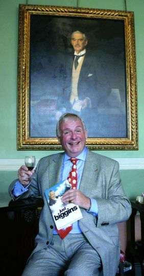 Christopher Biggins holding his autobiography. Taken at The Carlton Club, London, 2009