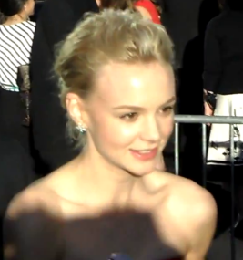 Carey Mulligan signing autographs for fans at The Great Gatsby premiere 2013. [Wikimedia]