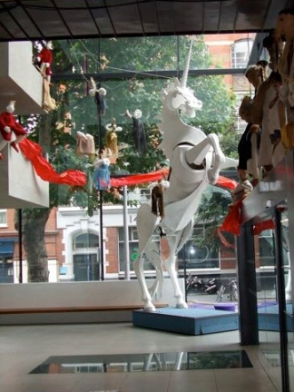 The foyer of the Unicorn Theatre, with its famous unicorn, decorated with some of Speeltheater's puppets. Photo: © Sarah Vernon