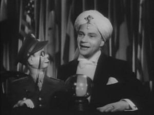 Bergen with his ventriloquist dummy Charlie McCarthy in Stage Door Canteen (1943) [Wikipedia]