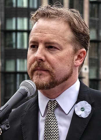 Samuel West wearing a Peace Pledge Union poppy at the No Glory protest, London, 4th August 2014 [Wikipedia]