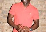Actor Jimmy Akingbola on a photo shoot (London, 2010)[Wikimedia]