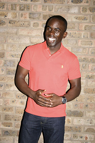 Actor Jimmy Akingbola on a photo shoot (London, 2010)[Wikimedia]